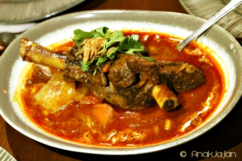 Massaman Curry of slow-braised Lamb Shank with Cardamom, shallots, pumkins and thamrind