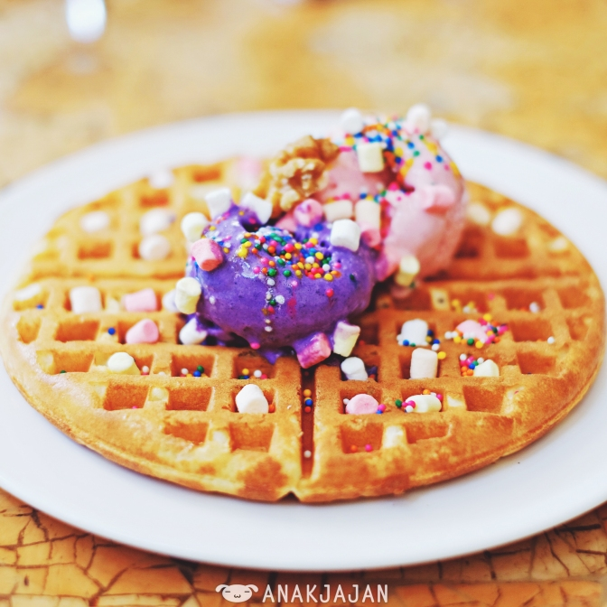 Freshly made waffle with ube ice cream