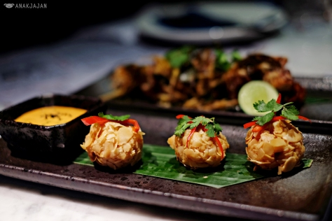 Deep fried prawn and almond ball with sriracha coriander aioli IDR 48k