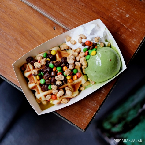 Belgian Liege Waffle Green Tea IDR 35k served with Green Tea Ice Cream, Whipped Cream, M&M's and Rhum Raisin Sauce