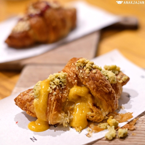 Salted Egg Yolk Lava Croissant IDR 30k https://anakjajan.com/2016/03/11/saturday-brunch-at-nomz-kitchen-pastry-jakarta-grand-indonesia/