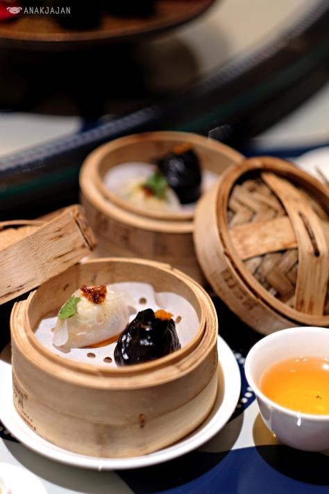 Spicy XO Scallop Dumpling IDR 32k// Squid Ink, Seafood and Fish Roe Dumpling IDR IDR 32k