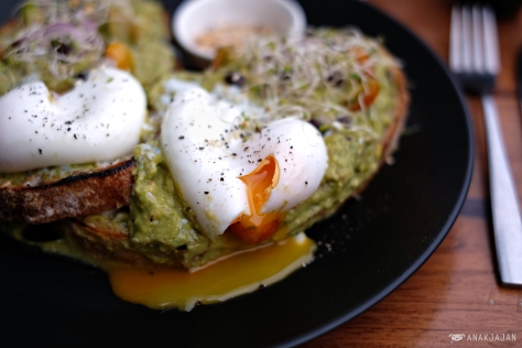 Smashed Avocado and Feta Cheese with Poached Egg on Sourdough IDR 65k