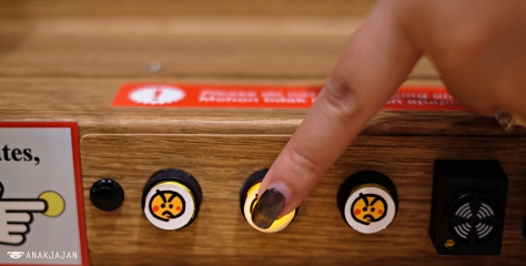 push the button to return the sushi train